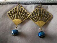 Fan-shaped Bronze Earrings with blue drop