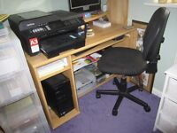 A large desk with shelves for printers, a leaf for extending the surface and a pull-out keyboardtray