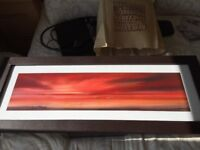 Sea scape/red sunset print, brown leather frame