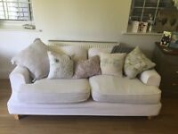 Cream sofa free to a good home.