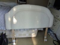 """Bed headboard to suit 4'- 0"""" bed in cream fabric finish in good condition."""