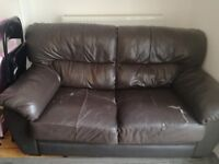 Two brown faux leather sofas free