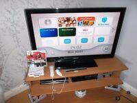 Nintendo Wii console with games controller nunchuck sensor etc