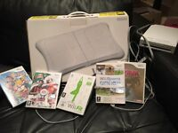 Nintendo wii, wii board and 5 games