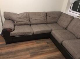 Brown L shaped couch