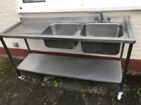 Used Stainless steel double sink unit on wheels.