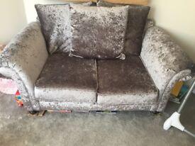 Glitz grey Velvet two seater sofa.