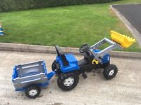 Rolly New Holland Tractor with Front Loader and Trailer. Excellent Condition.
