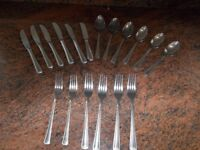 A S/STEEL CUTLERY SET COMPRISING OF 6 KNIVES, 6 FORKS, AND 6 DESSERT SPOONS
