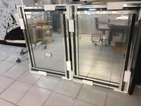 2 Large brand new mirrors, available for pick up