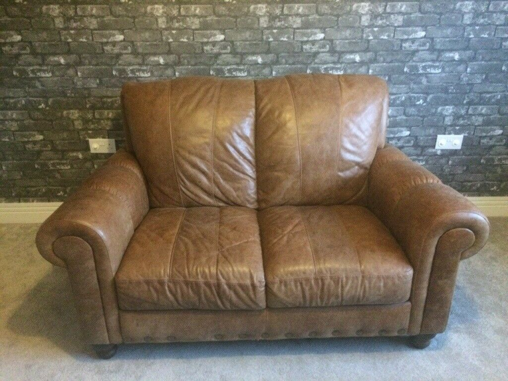 Beautiful 2 seater sofa and chair in distressed leather