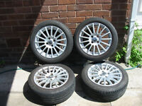 toyota yaris alloy wheels and tyres 195/50 15 uniroyal ex con with locking nuts