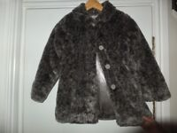 Girls Coat. Faux fur. Fully lined. Suit 8 year old. Excellent condition.