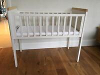 Small cot and new mattress