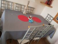 Large glass dining table and 6 chairs