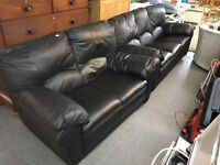 A THREE AND TWO SEATER BLACK LEATHER SOFAS