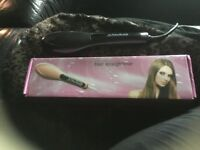 Straightening brush plug in brand new colour black haven't used them as got ghds