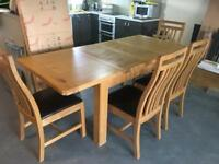OAK EXTENDABLE DINING TABLE AND FOUR CHAIRS