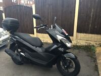 2015 Honda scooter,125 PCX (one owner)black gloss, almost brand new , 130 miles only