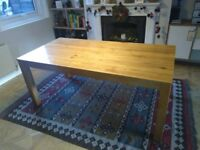 Solid wood oak dining table easily seats six