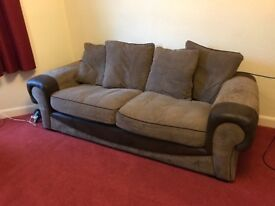 Brown fabric and suede 3/4 seater sofa. From pet and smoke free home.