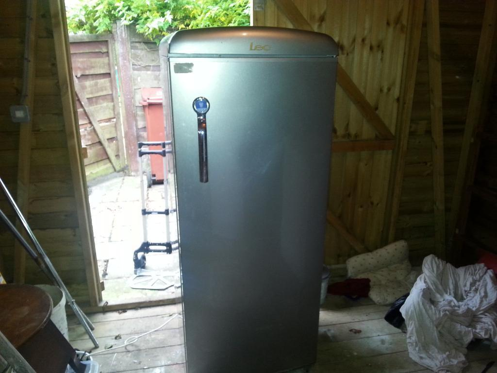 upright silver fridge good clean condition can deliver phone only please no time wasters