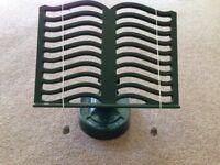 Dark green cast iron book rest with adjustable rest