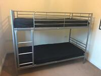 Single metal frame bunks with like new mattresses, used in guest room a handful of times