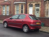 Reliable dark red Peugeot 206