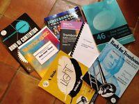 Assorted trombone music books.