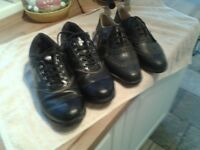 2 pair of golf shoes