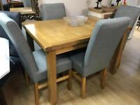 Solid Oak Extending Dining Table & 4 Grey Fabric and Solid oak Dining Chairs