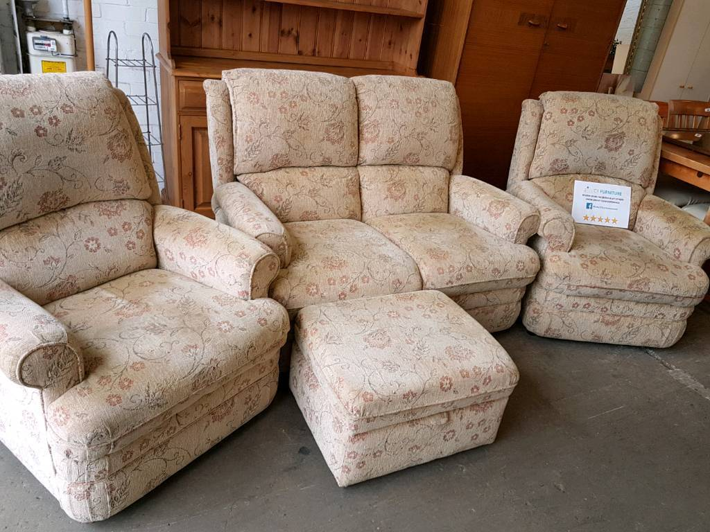 Beige fabric patterned two seater sofa with two armchairs and pouffe