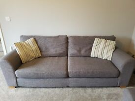 Grey four seat sofa