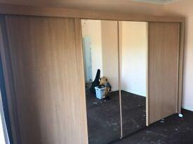 Large beech effect sliding door wardrobe