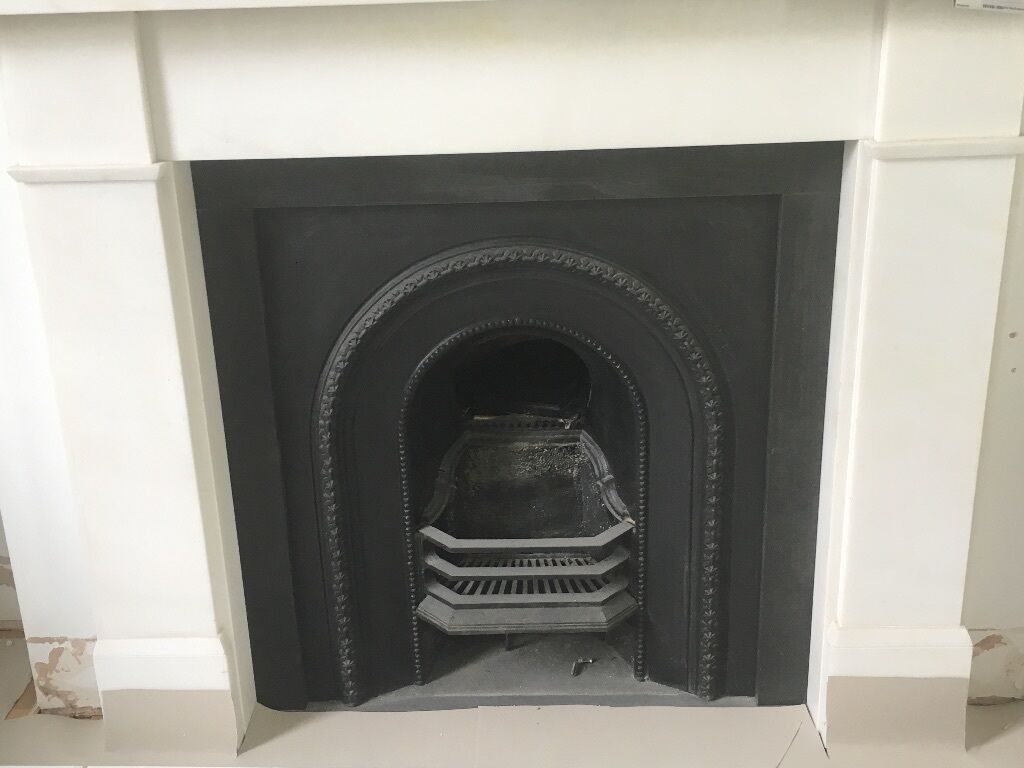 white marble victorian fireplace with black slate hearth and slip