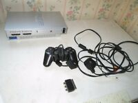 silver ps2 console bundle,4 games+ controller
