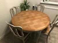 Round dining room table with insert plus chairs