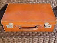 Vintage brown leather suitcase.
