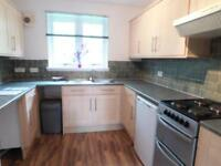 Beautiful two bedroom upper cottage flat in quiet location close to town and schools..