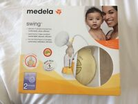 Madela breast feeding pump and 2 breast feeding covers