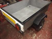 Metal box trailer with tailboard