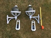 A pair of outdoor lights white metal, good condition. About 16 inches high