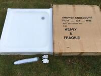 Unused white acrylic shower tray