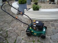 PETROL LAWNMOWER STARTS AND RUNS NO MAKE ON IT ONLY £25 FOR QUICK