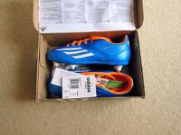Various Adidas football soft ground and indoor/astro turf boots