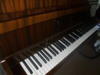 upright piano by squire