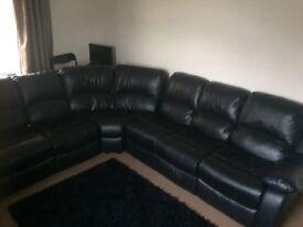 Black leather reclining corner sofa