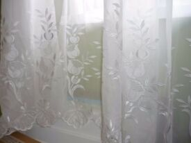 Large white voile net curtain with flower pattern