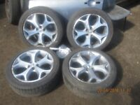 Set of 4 Alloys Snow Flakes with Tyres 235/45 18 3 Really Good Tyres 1 Okay.